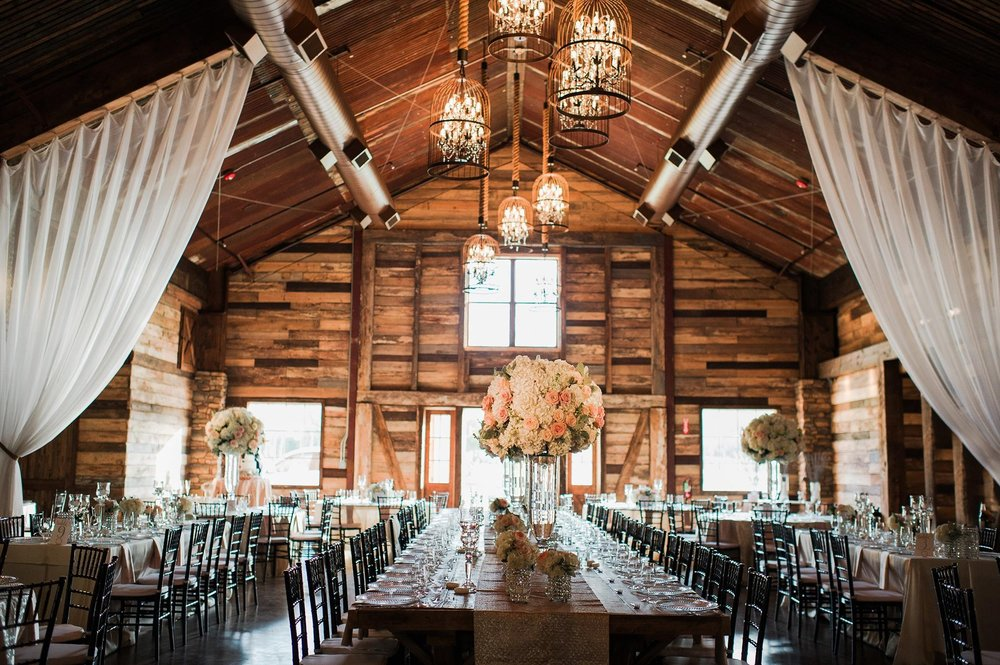 How To Plan Inexpensive Wedding Venues Houston: Elegant Barn Wedding Featuring Bold Red Blooms By