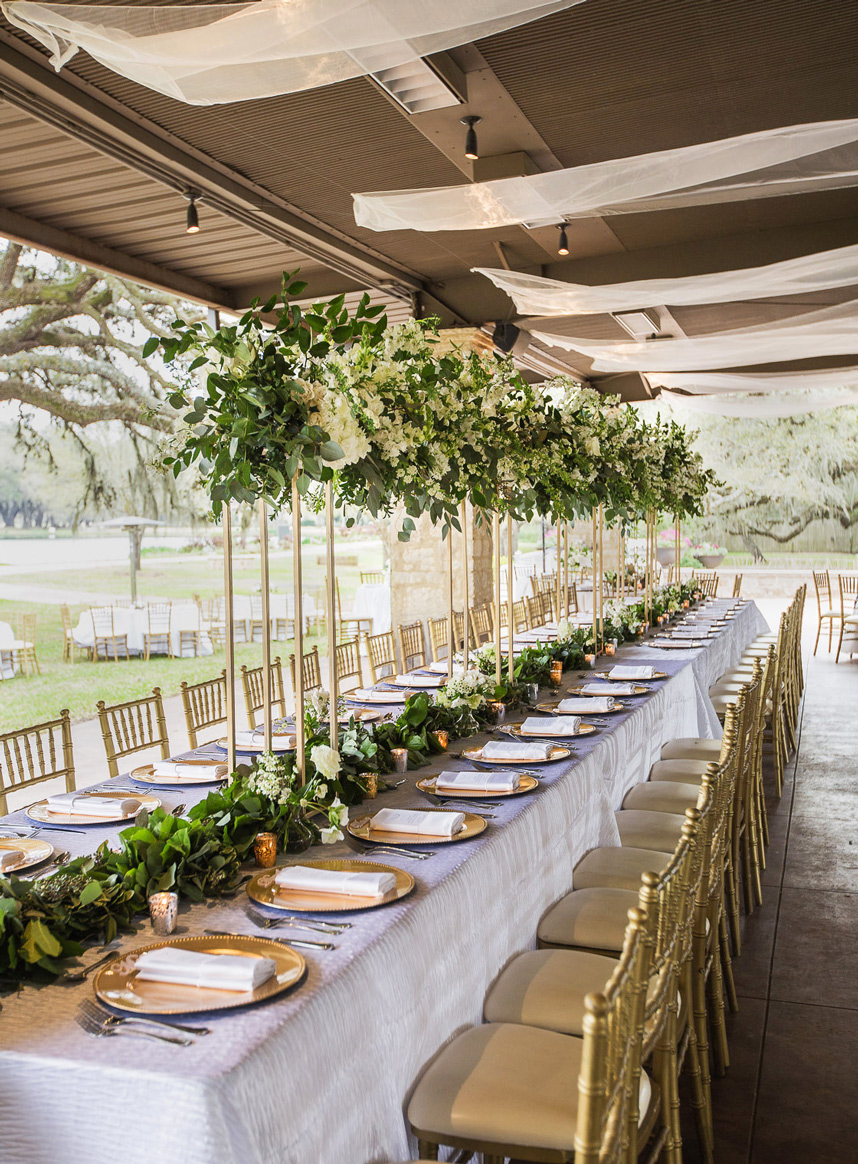 large wedding table from houston wedding planner alyssa meeks explaining ways to make a large wedding feel intimate