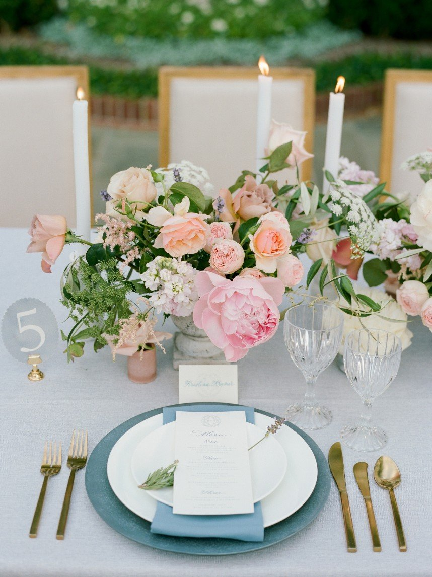 french country wedding vignette showing how guest count can affect wedding budget