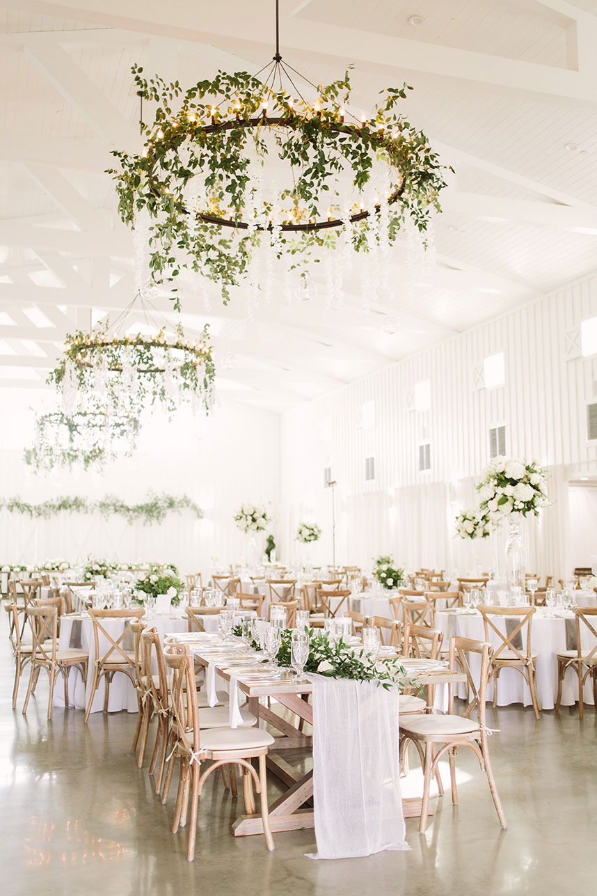 wood chairs with white tables wedding setup + tips for creating your guest list